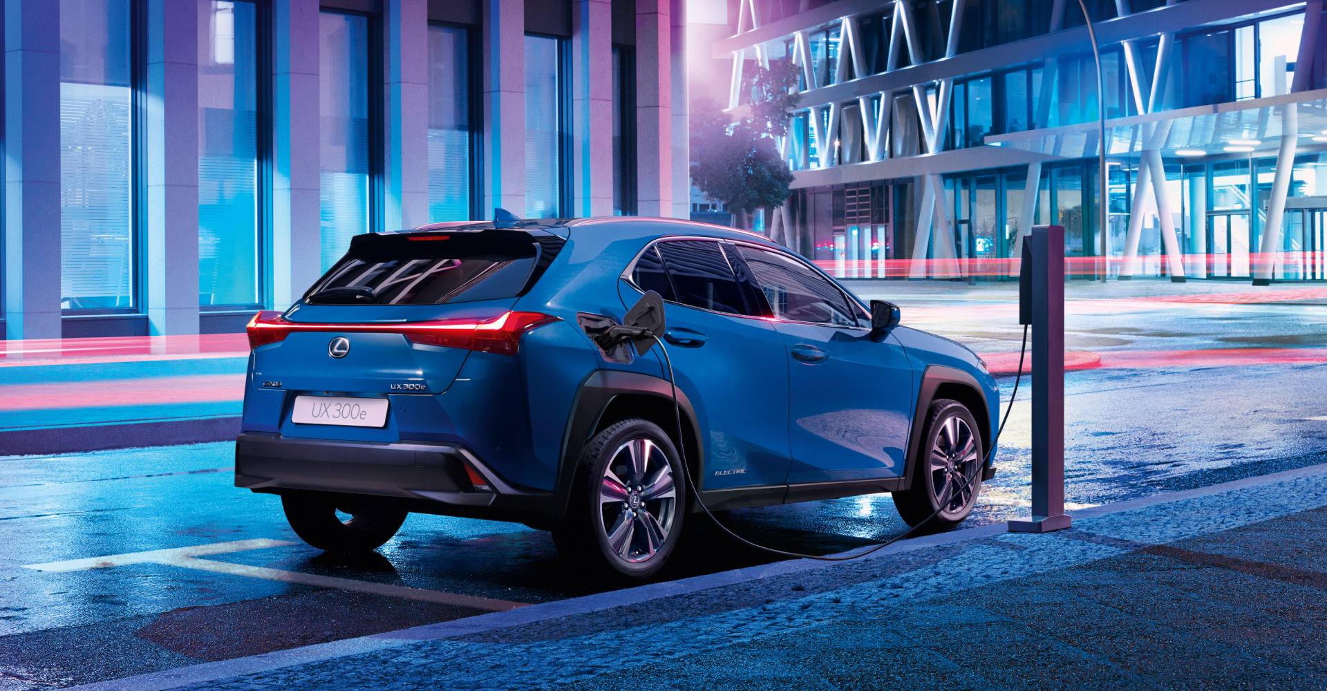 Lexus UX EV charging at night